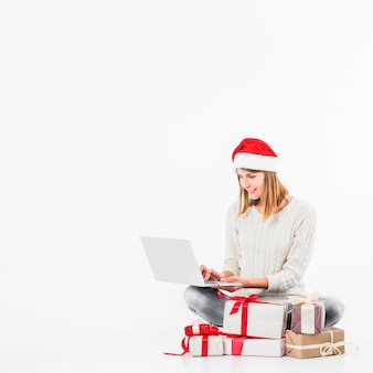Woman sitting with laptop on floor