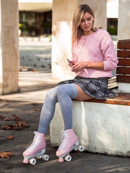 Woman sitting with socks on and roller skates