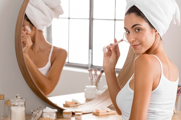 Woman sitting with towel next to the mirror