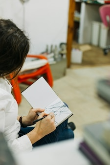 Woman sketching with fine liner