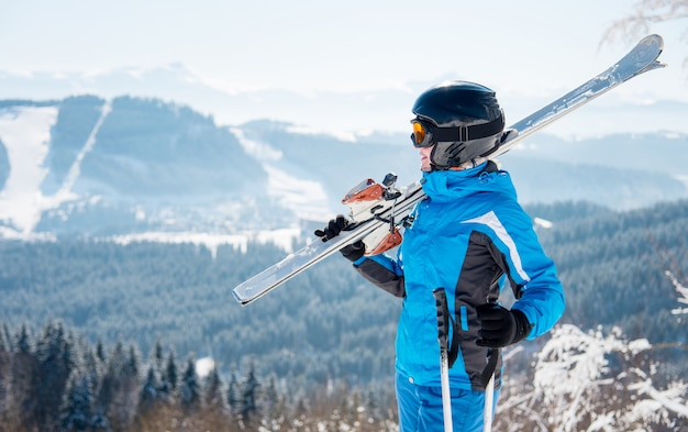 Woman skier on slope in the mountains