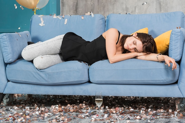 Woman sleeping after party