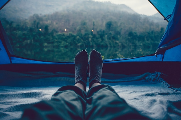 Woman sleeping in a tent with an amazing view