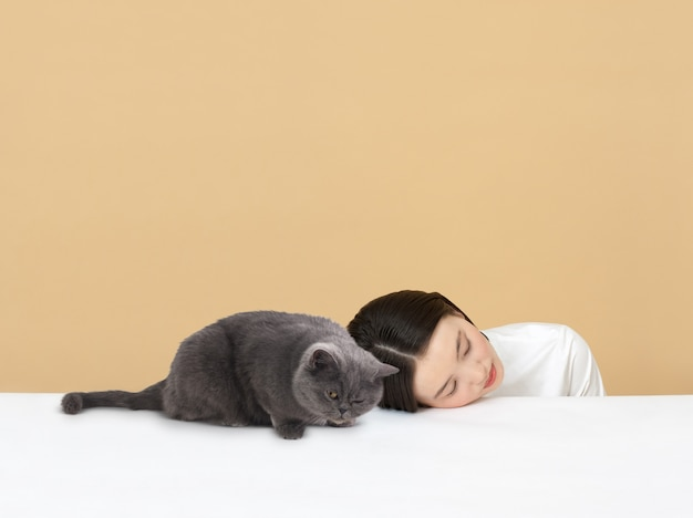 Woman sleeping with the cat