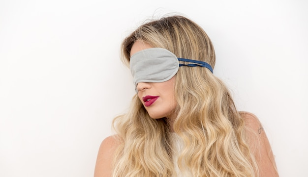 Woman sleeping with eye mask.