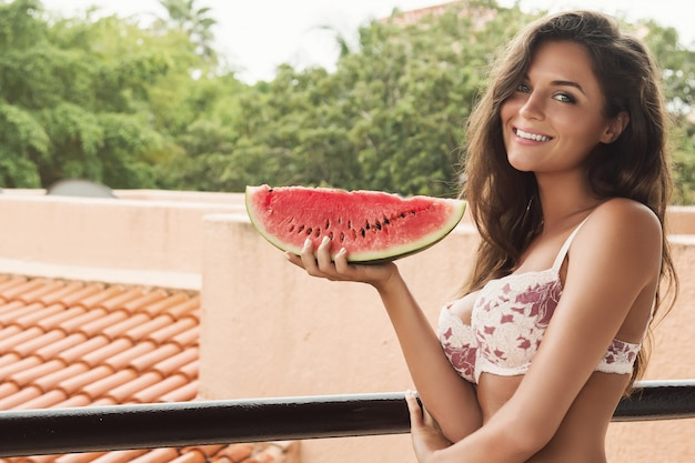 Woman and slice of watermelon