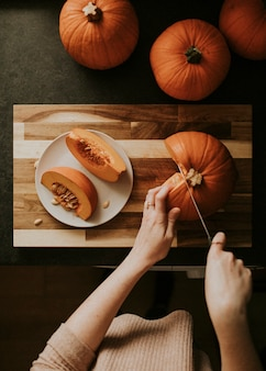 Woman slicing pumpkins