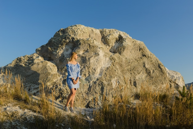Woman on small mountain in the open air