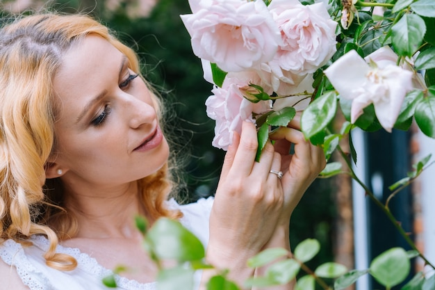 Woman smelling and enjoying beautiful roses