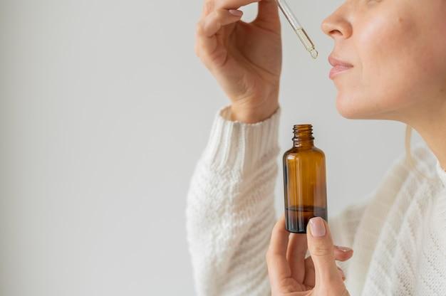Woman smelling serum