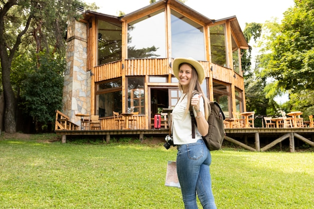 Woman smiling at camera in front of a modern house