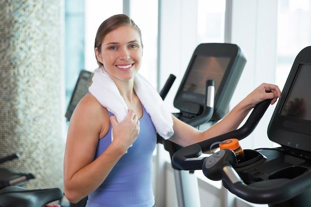 Woman smiling on an elliptical brace