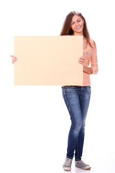 Woman smiling holding a blank poster