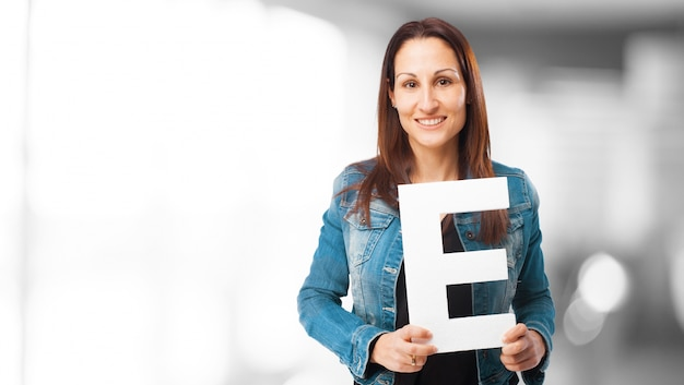 Woman smiling holding the letter