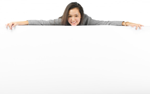Woman smiling showing white blank sign billboard