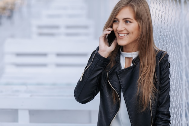 Woman smiling and talking on the phone