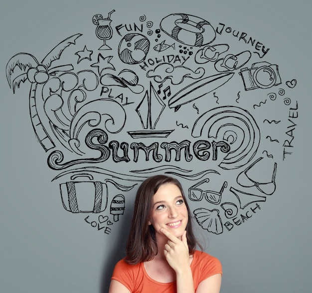 Woman smiling thinking of her summer vacation