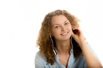 Woman smiling while listen music