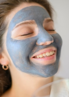 Woman smiling while wearing face mask