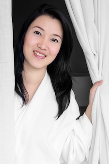 Woman smiling white robe.