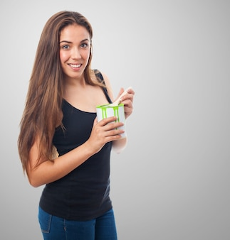 Woman smiling with a can of green paint
