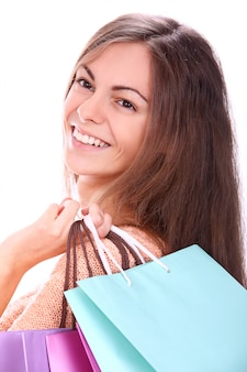 Woman smiling with colourful shopping bags