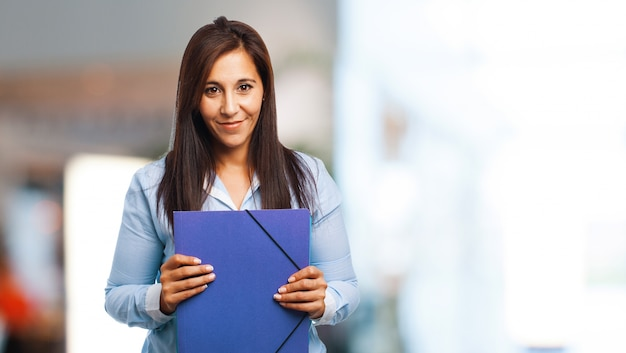 Woman smiling with a folder