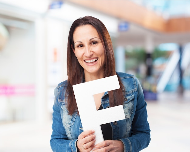 Woman smiling with letter