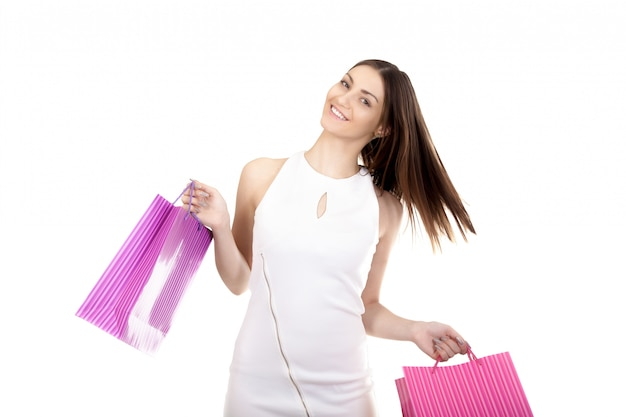 Woman smiling with purchase bags