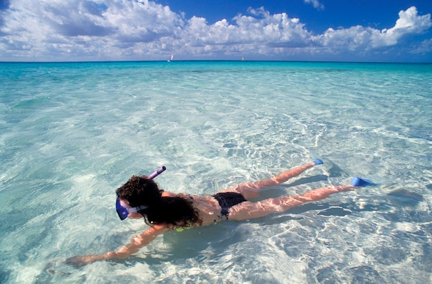 Woman snorkeling, isla majuerhus, mexico