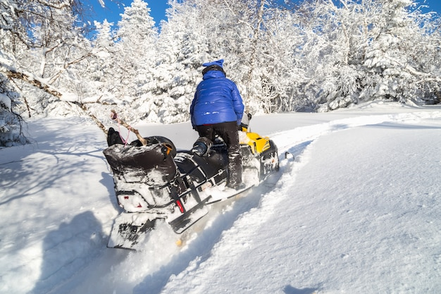 Woman on a snowmobile.