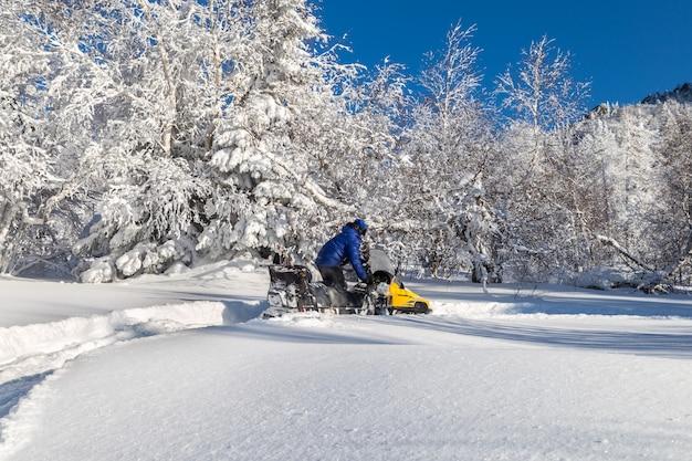 Woman on a snowmobile