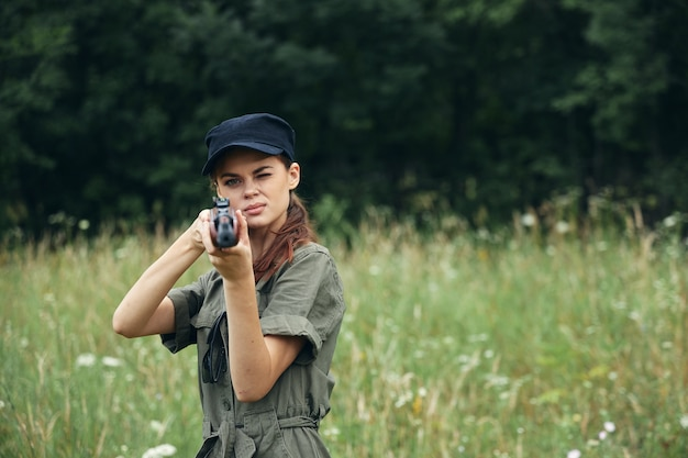 Woman soldier looking ahead weapon hunting weapons