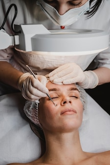 Woman at the spa during a skin treatment
