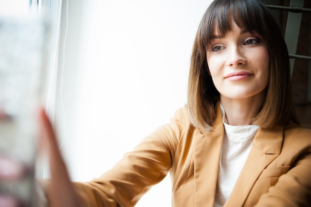 Woman speak by videoconference on her smartphone
