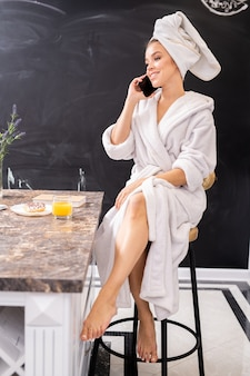Woman speaking by phone in spa