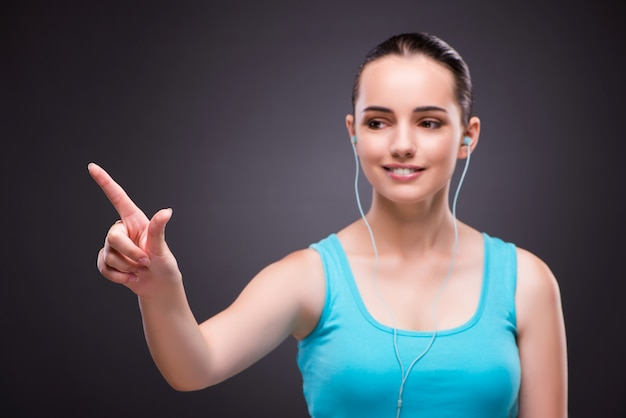 Woman in sports concept pressing buttons