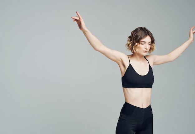 Woman in sports uniform yoga balance fitness slim figure