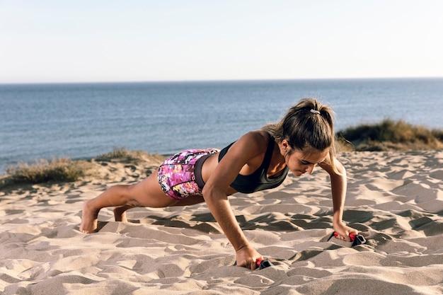 Woman in sportswear doing push ups