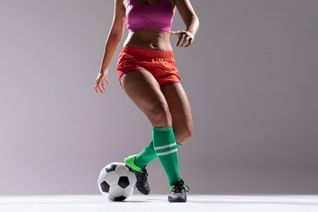 Woman in sportswear playing football