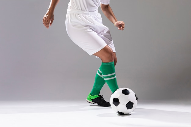Woman in sportswear playing with ball
