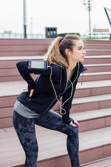 Woman in sportswear suffering from back pain after training