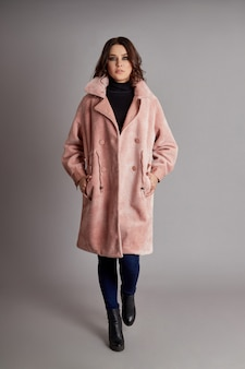 Woman in spring, autumn coat fashion on grey