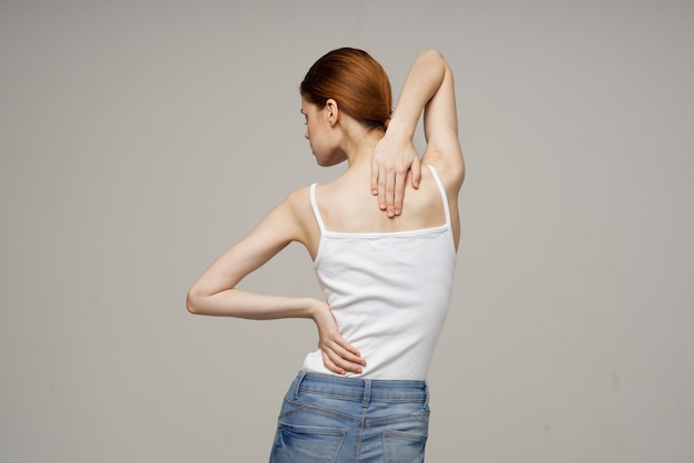 Woman standing back massage scoliosis medicine isolated background