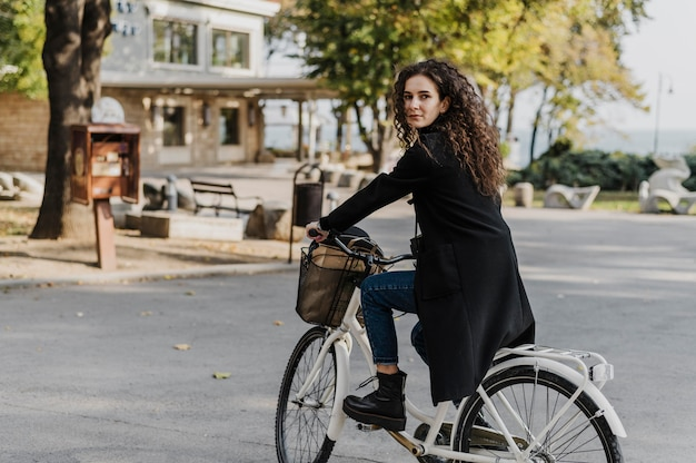 Woman standing on the bicycle long shot