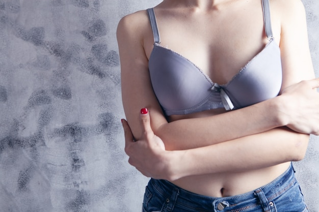 Woman standing in bras with her arms crossed