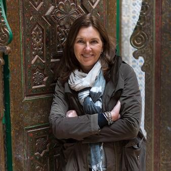 Woman standing at the doorway of kasbah of glaoui, telouet, ouarzazate, souss-massa-draa, morocco