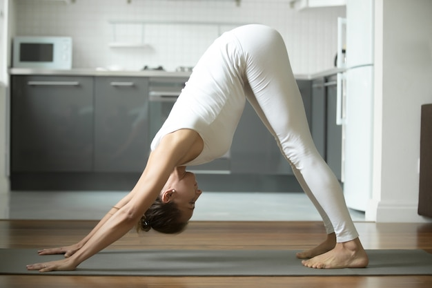 Woman standing in downward facing dog exercise
