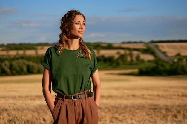 Woman standing farmland wheat field