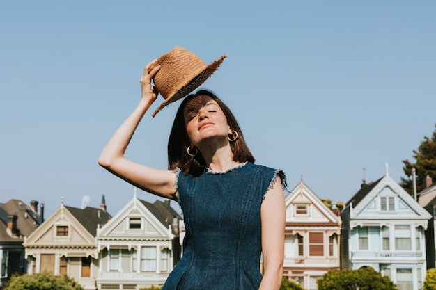 Woman standing in front of the painted ladies of san francisco, usa